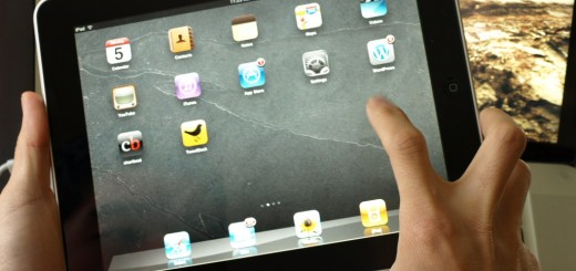 ipad-in-hand-homescreen
