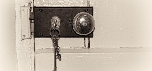 locked-door-from-inside-with-key-in-lock-1000px