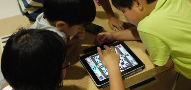 kids ipad The legal loophole of advergames: How ads disguised as video games are impacting todays youth