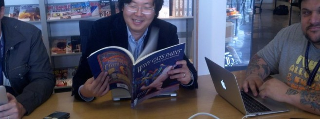 All sizes | Ben Huh reading a cat book. Yep, my life is surreal today. | Flickr – Photo Sharing!