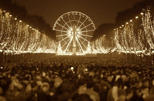 crowd and ferris wheel sepia1 520x342 The Best Places in the World to be on New Years Eve