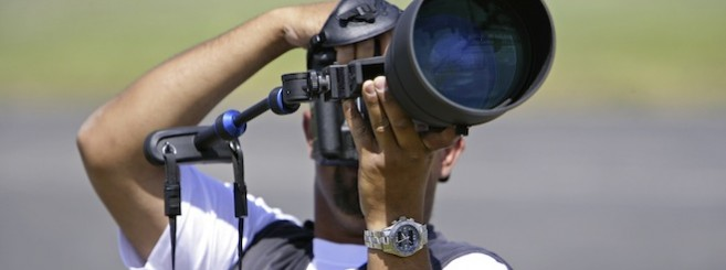 photographer with zoom lens