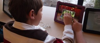 kid using ipad by flickingerbrad