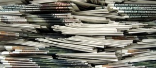 newspaper-stack-520×245