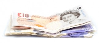 Pile of Britisch pounds on white background with shadow