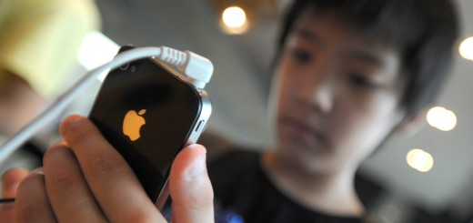 A South Korean boy uses an iPhone 4 at a