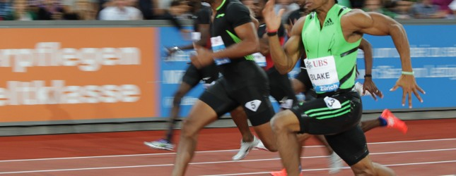 Jamaica's Yohan Blake (R) and Asafa Powe
