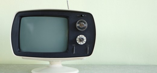 Still life of vintage television set with antenna raised.