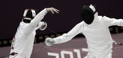 Andrei Moiseev of Russia (L) competes against Jung Jinhwa of South Korea (R) during the fencing epee one touch part of the Modern Pentathlon at the London 2012 Olympic Games in London on August 11, 2012. AFP PHOTO / ADEK BERRY        (Photo credit should read ADEK BERRY/AFP/GettyImages)