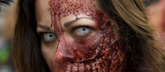 A woman dressed up as a zombie takes par