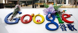 Bouquets of flowers lie on the Google lo