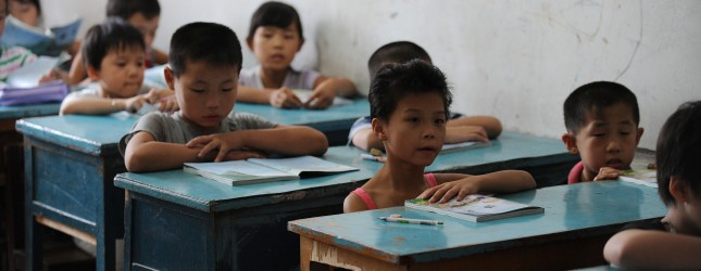 Chinese school children attend lessons a