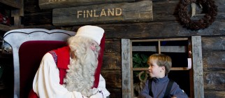 Santa Claus receives a wish list from a