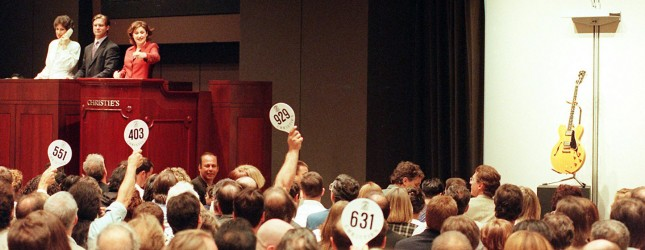 Bidders raise their paddles 24 June, 1999 for one