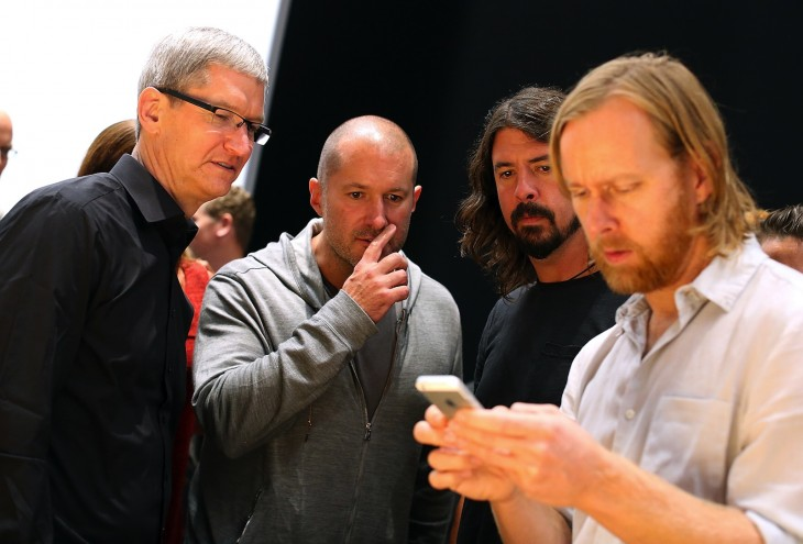 cook grohl and ive look at iphone 5 via getty images 730x495 2012s biggest tech news in pictures