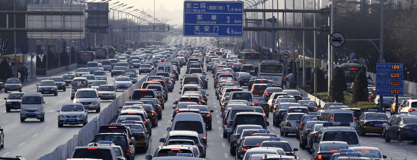 Vehicles are seen in a traffic jam durin