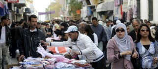 A Tunisian street vendor displays his go