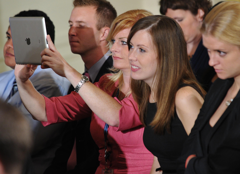 """An attendee uses an iPad during a """"Twitt"""