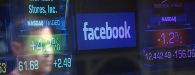 A Facebook logo is seen through the wind