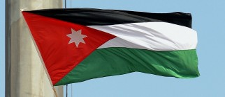 A man waves a Jordanian flag as Pope Ben