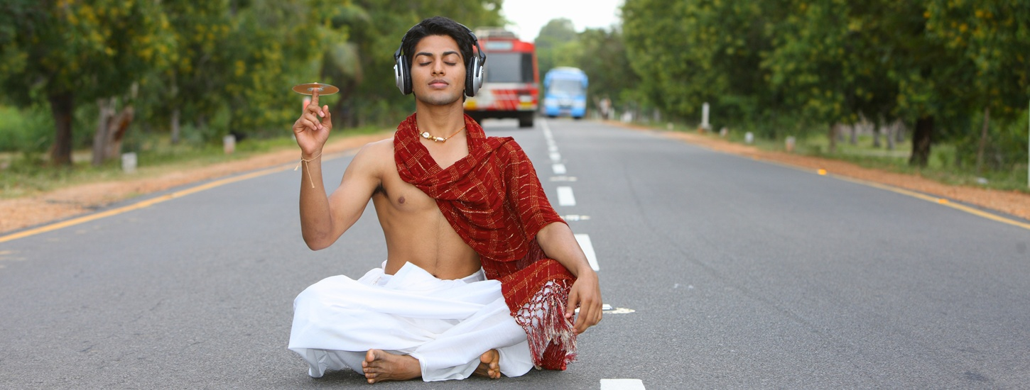Indian man with headphones