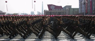 North Korean soldiers march during a mil