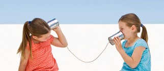 Twin girls with tin can telephone
