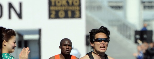 Kazuhiro Maeda (R) of Japan crosses the finish line of the Tokyo Marathon 2013 in Tokyo on February 24, 2013, while James Kwambai follows him. Maeda finished the fourth with a time of 2 hours 8 minutes, while Kwambai finished fifth with a time of 2 hours 8 minutes 02 seconds.  AFP PHOTO / Rie ISHII        (Photo credit should read RIE ISHII/AFP/Getty Images)