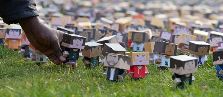 foldableme1 730x319 Thousands of tiny cardboard people stage a protest outside the Houses of Parliament in London