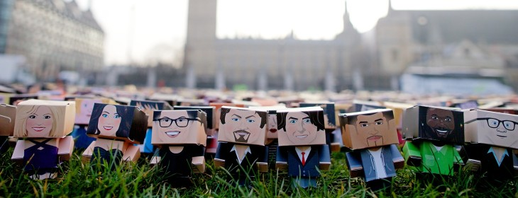 foldableme3 730x280 Thousands of tiny cardboard people stage a protest outside the Houses of Parliament in London
