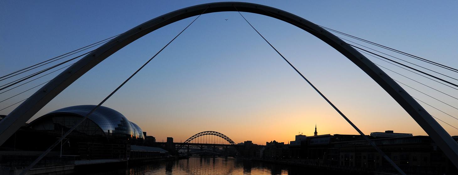The sun sets behind the Tyne Bridge over