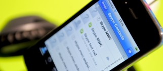 A smartphone shows a Skype application a