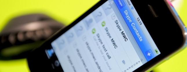 A smartphone shows a Skype application a