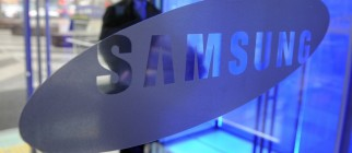 A visitor walks past the logo of Samsung