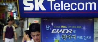 A South Korean man checks his telephone