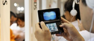 Visitors examine Nintendo's portable vid