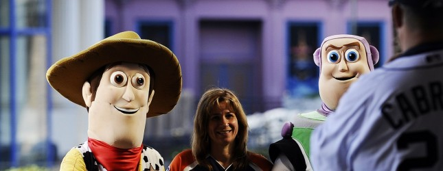 Two workers dressed as Woody (L) and Buz