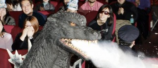 "TOKYO, JAPAN:  Japan's star monster Godzilla walks before an audience during the ""Godzilla Final Wars"" movie opening day event in Tokyo, 04 December 2004. ""Godzilla Final Wars,"" studded with other star monsters Godzilla battled in past films, opened in Japan after the world premiere at Hollywood's famed Grauman's Chinese Theater last month.   AFP PHOTO / TOSHIFUMI KITAMURA  (Photo credit should read TOSHIFUMI KITAMURA/AFP/Getty Images)"