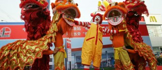 A lion dance troupe performs with Ronald