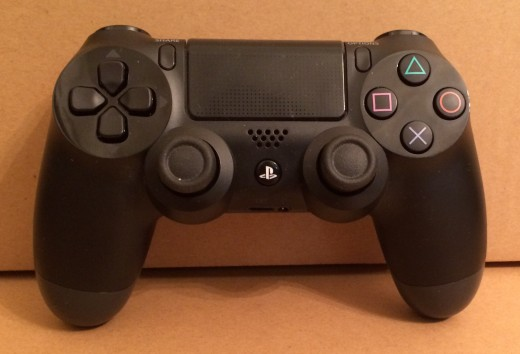 ps4 controller 520x354 PlayStation 4 review: Technical issues hold back Sony from greatness