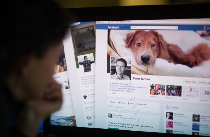 A woman watches a Facebook promotional v