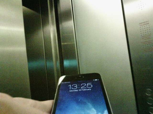 Checking my phone in a lift