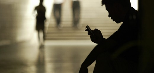 A man uses his mobile phone for messagin
