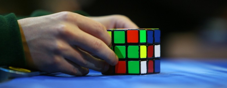 A competitor tries to solve the Rubik cu