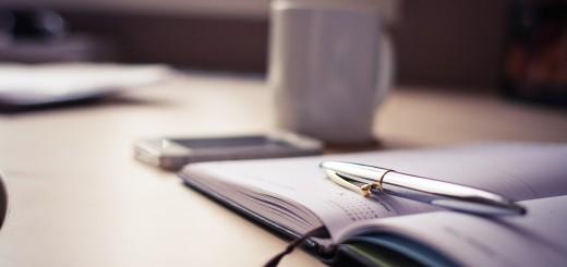 pen notebook desk