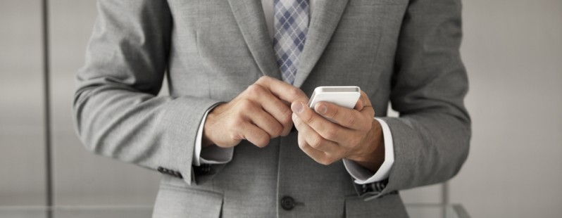 business man texting phone