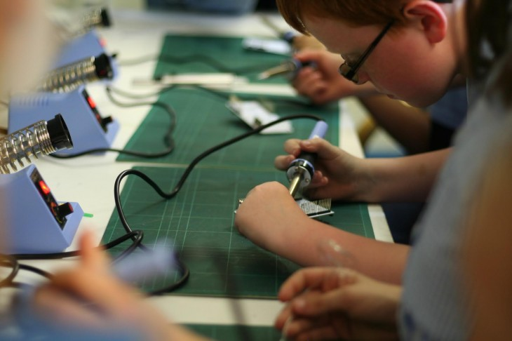 soldering 730x486 Google donates $100,000 to help kids build their own games consoles