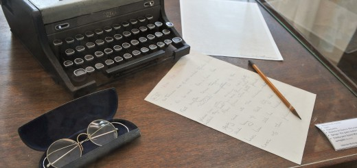 The typewriter, glasses, pencil and othe