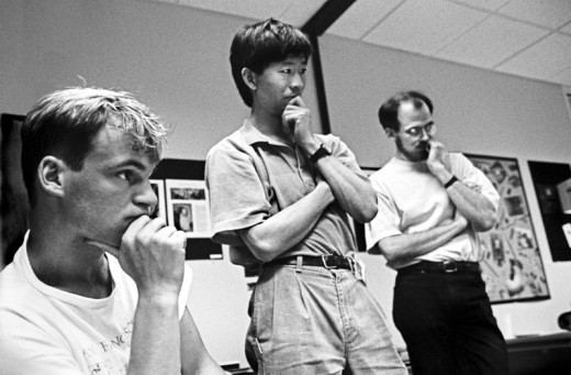 At-the-1990-Adobe-Photoshop-Invitational,-members-of-Adobe's-creative-team-(back-row,-from-left)_-Min-Wang-and-Russell-Brown-along-with-an-unidentified-artist,-1990