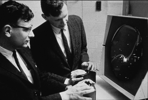 Dan Edwards (left) and Peter Samson (right) playing Spacewar! on the PDP-1